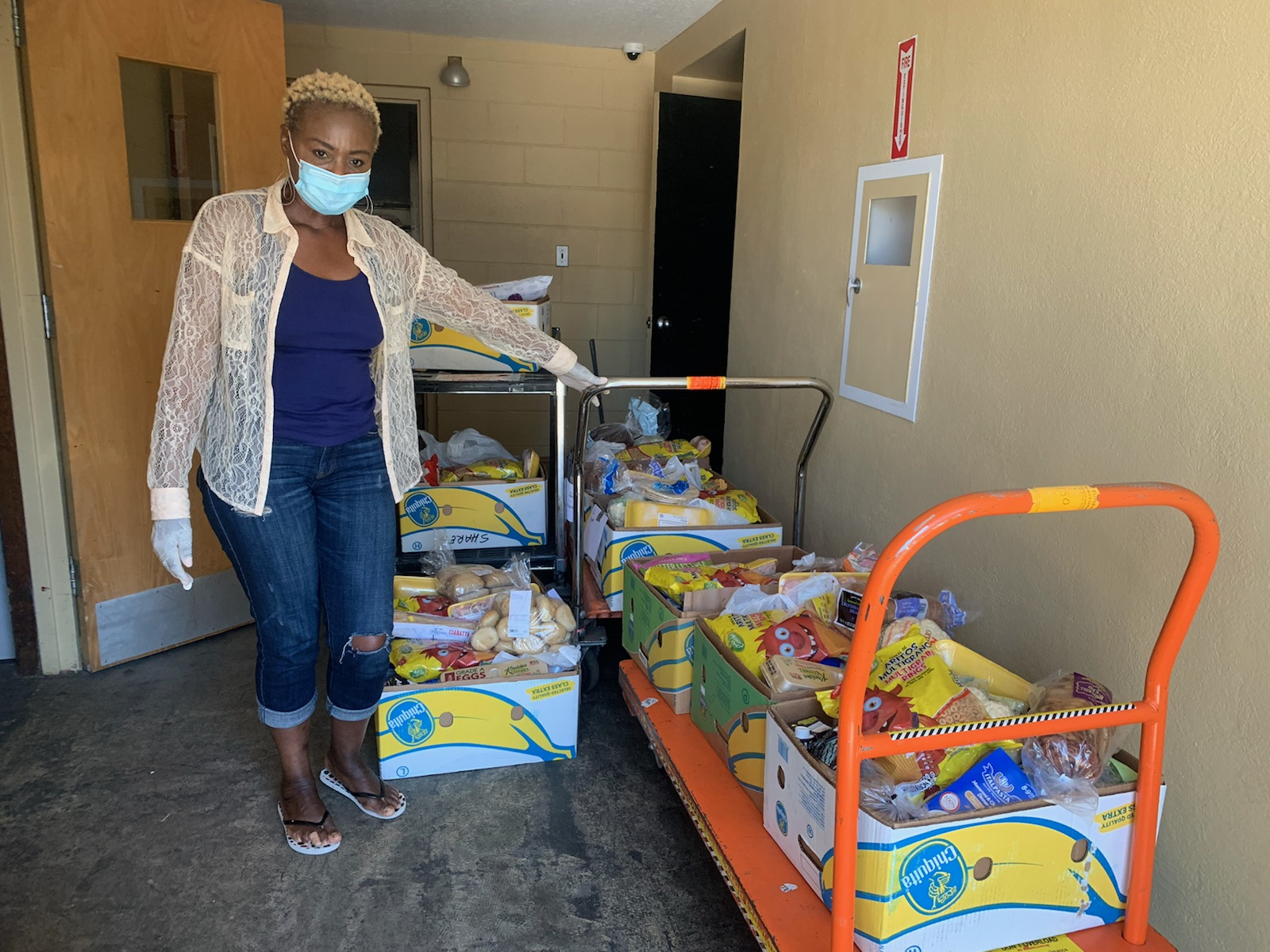 Florence, a Nurse Practitioner, is ready to load and deliver food to those who are home and can't go out because of COVID-19